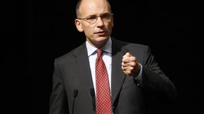 razno 01.10.13. Italy's Prime Minister Enrico Letta gestures during a meeting in