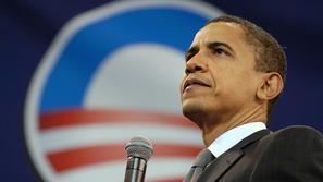 US Democratic presidential candidate Senator Barack Obama (D-IL) pauses while ad