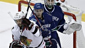 Schneider Corrado Bollig Vancouver Canucks Chicago Blackhawks NHL