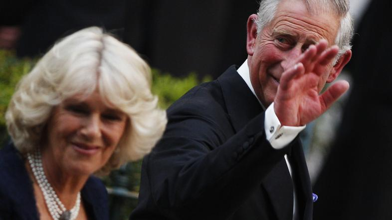 razno 12.11.13. Britain's Prince Charles (R) and his wife Camilla arrive for a p